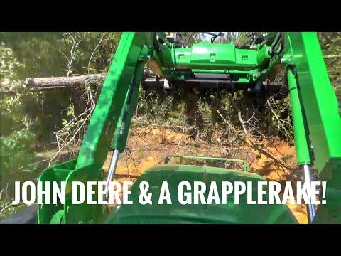 John Deere 5075E tractor and grapplerake working!