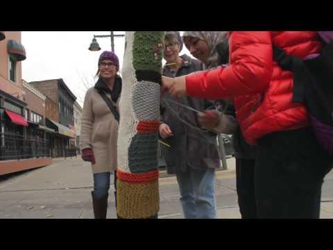 Iowa Intensive English Program's Knitting Club Installs Hand-Knitted Sweater on Tree