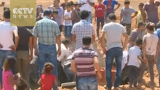 Funerals held for drowned Syrian boy and family