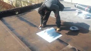 FLAT ROOF INSTALLATIONS: how install a 3 ply heat weld system