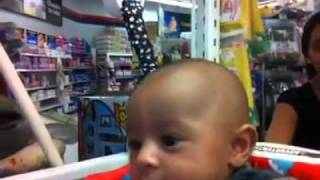 Baby Lorenzo At WalMart on his new fisher price toy