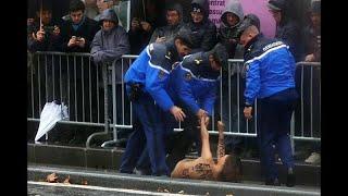 القبض على متظاهرة عارية الصدر حاولت الوصول لموكب ترامب في باريس…