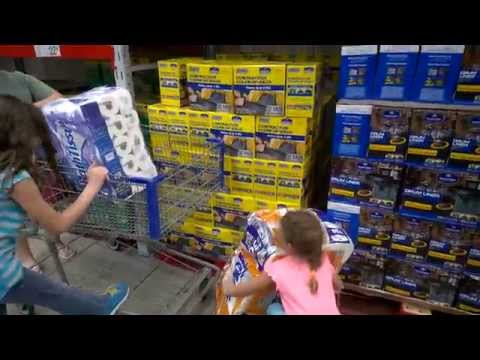 5 year old girl loading shopping cart