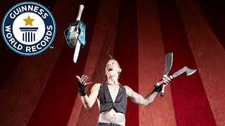 Under leg chainsaw juggling - Guinness World Records