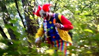 creepy clown attacks kids in the woods