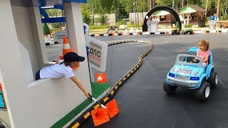 Milana and NIka play with car on playground for Kids.