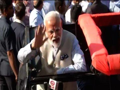 PM Narendra Modi waves, shows inked finger after casting vote