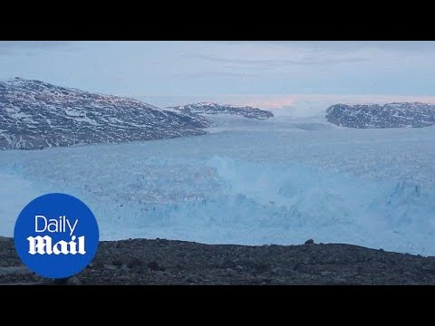 Four mile long iceberg breaks off a Greenland glacier