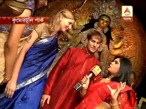 Foreigners enjoy Durga Pujo in  Kumartuly park pandle