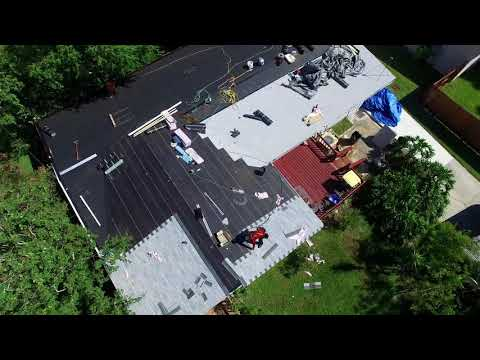 A.J. Wells Roofing Contractors Jacksonville Florida Roof Replacement laying shingles drone footage