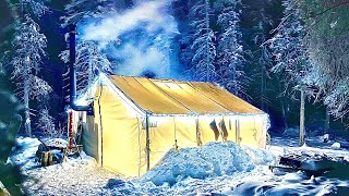 WINTER CAMPING in a GLOẄING HOT TENT HUT