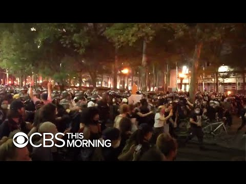 Police crack down on protesters defying curfew orders during confrontation in Brooklyn