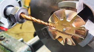 Крыльчатку из бронзы сделал на токарном станке.