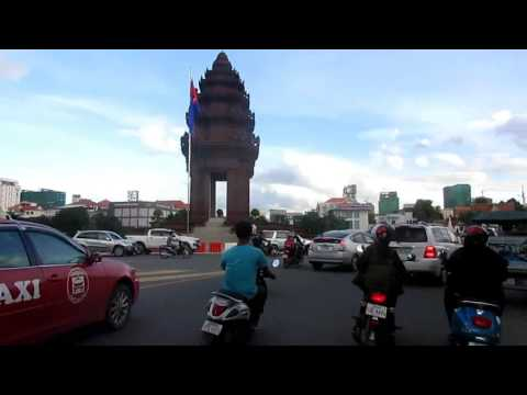 Driving around Phnom Penh in Cambodia by Motor on holiday Very Happy