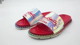 Christian Louboutin slippers on feet
