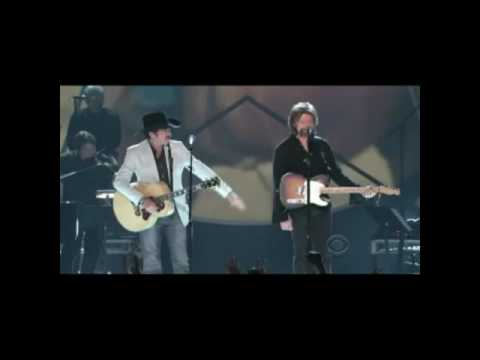 Brooks n Dunn cowboy rides away by George strait