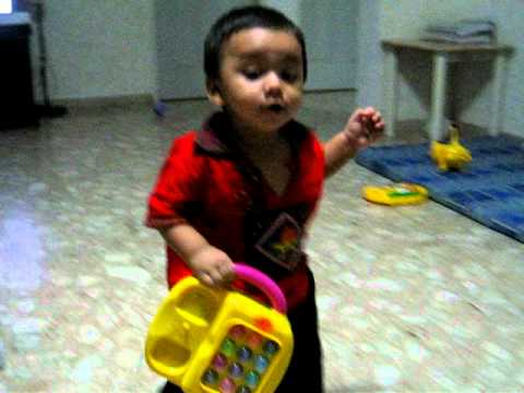 Faiaz walking with his music box cum telephone :)