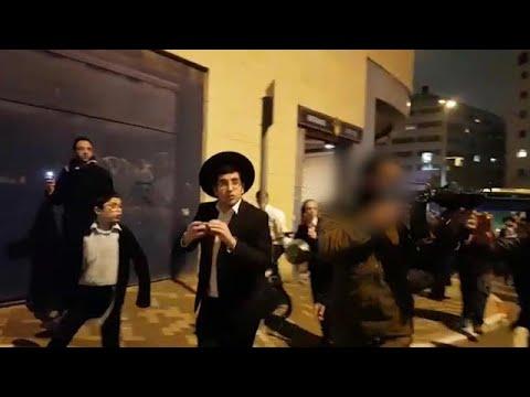 """חייל מכוון נשק הפגנה נגד גיוס חרדים ירושלים מעצר רבמאיר בלוי צה""""ל"""
