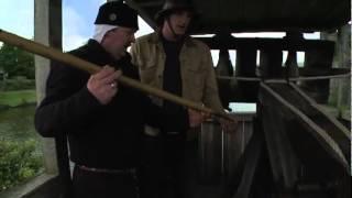 Battle Castle: host Dan Snow shoots a ballista at Caerphilly Castle
