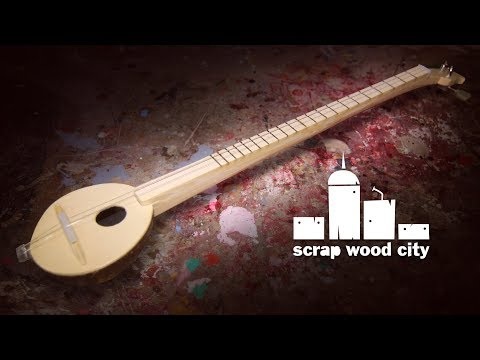 Making a 2 string musical instrument out of coconut and wood