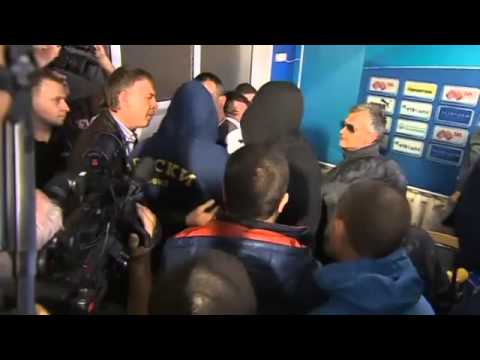 Angry football fans strip new coach at press conference