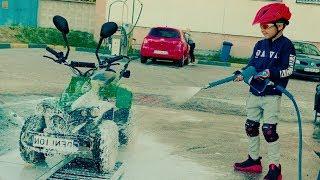 Washing green four-wheeled toy on a carwash