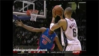 Kenyon Martin tosses the alley-oop to Richard Jefferson