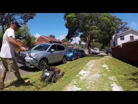 Lawn Mowing & Edging An Overgrown Sidewalk