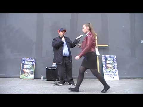 Crazy guy grabs hold of street preacher in Liverpool City Center