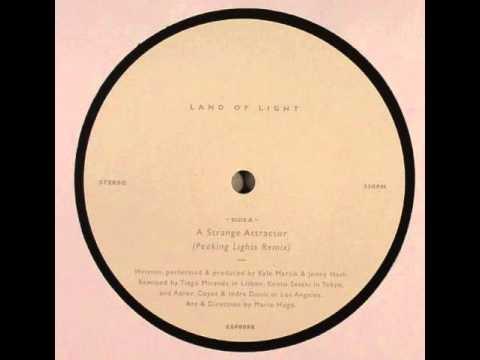 land of light - a strange attractor ( peaking lights remix )