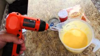 Mixing A Cake With A Power Tool.