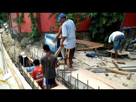 Boholano Workers Building a Drainage System