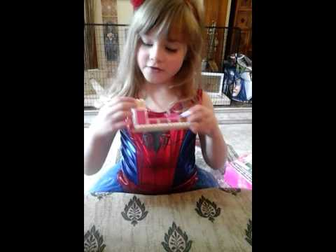 5 Year Old Girl Having Fun Building Barbie Mansion House While Dressed As Spidergirl
