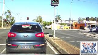 Police car crashes while responding through Red light - QLD