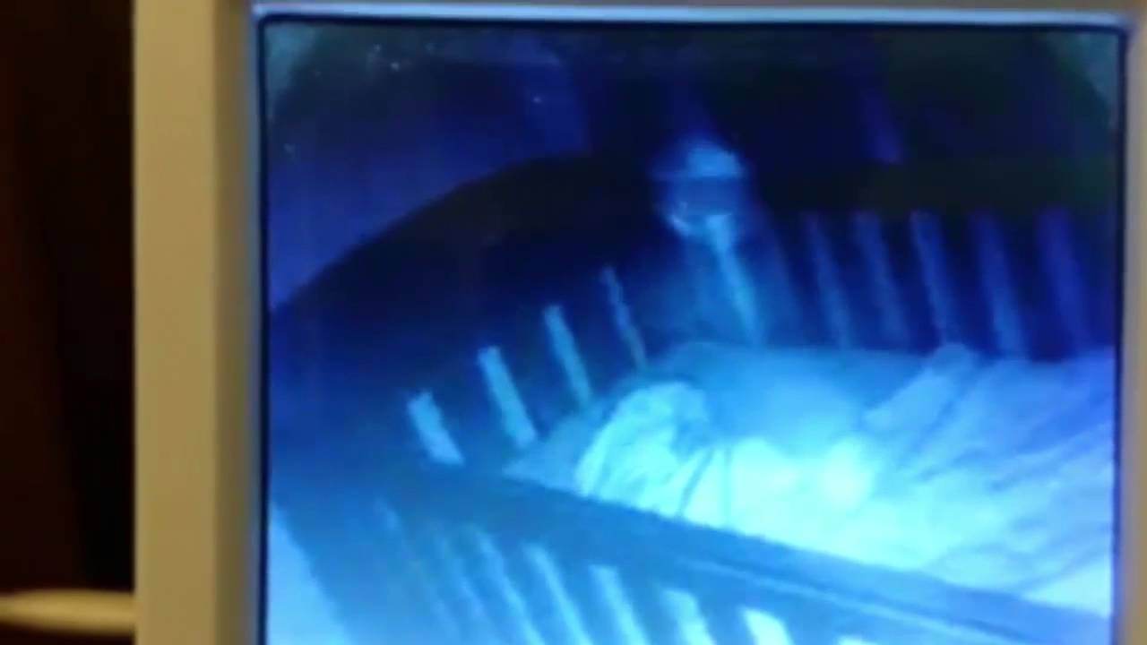 Baby Monitor Captures Ghost Of Toddler With Baby In Crib