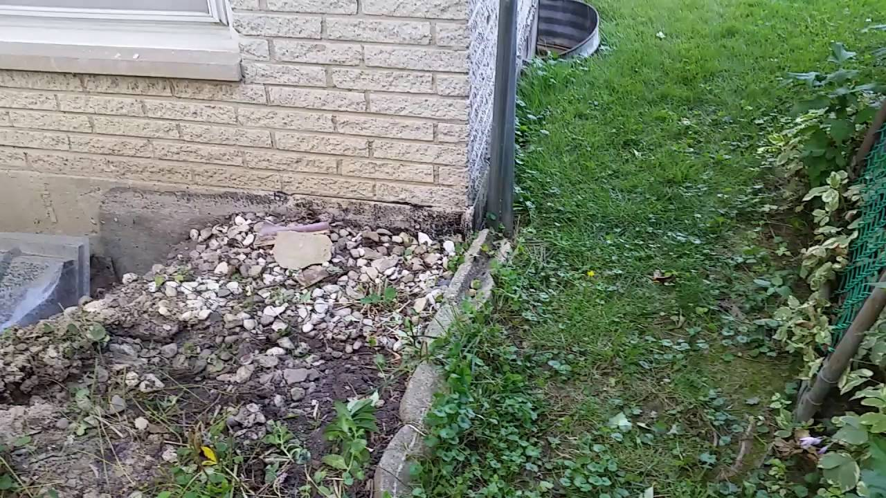 yard grading replacing window wells and installing french drains