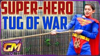 Superhero Tug Of War: Superman, Wonder Woman, Batman and Robin