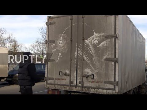 Russia: Filthy minded! Street artist draws masterpieces onto DIRTY trucks