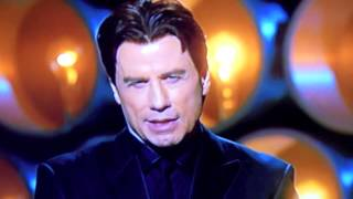 John Travolta at the Oscars introducing  . . .