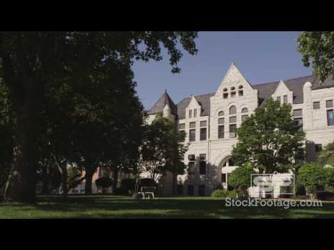 Dolly shot panning from behind a tree to Nemaha Courthouse in Nebraska.