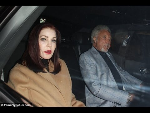 Sir Tom Jones Is Pictured With His Arm Affectionately Around Elvis' Wife Priscilla Presley