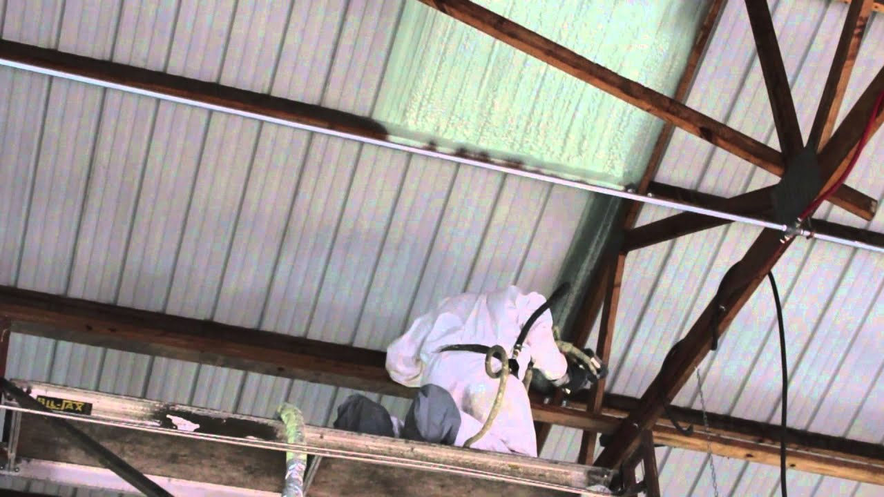 Closed Cell Spray Foam Insulation Being Applied To A Auto