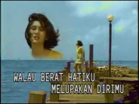 YouTube - Nike Ardilla - Sandiwara Cinta.flv