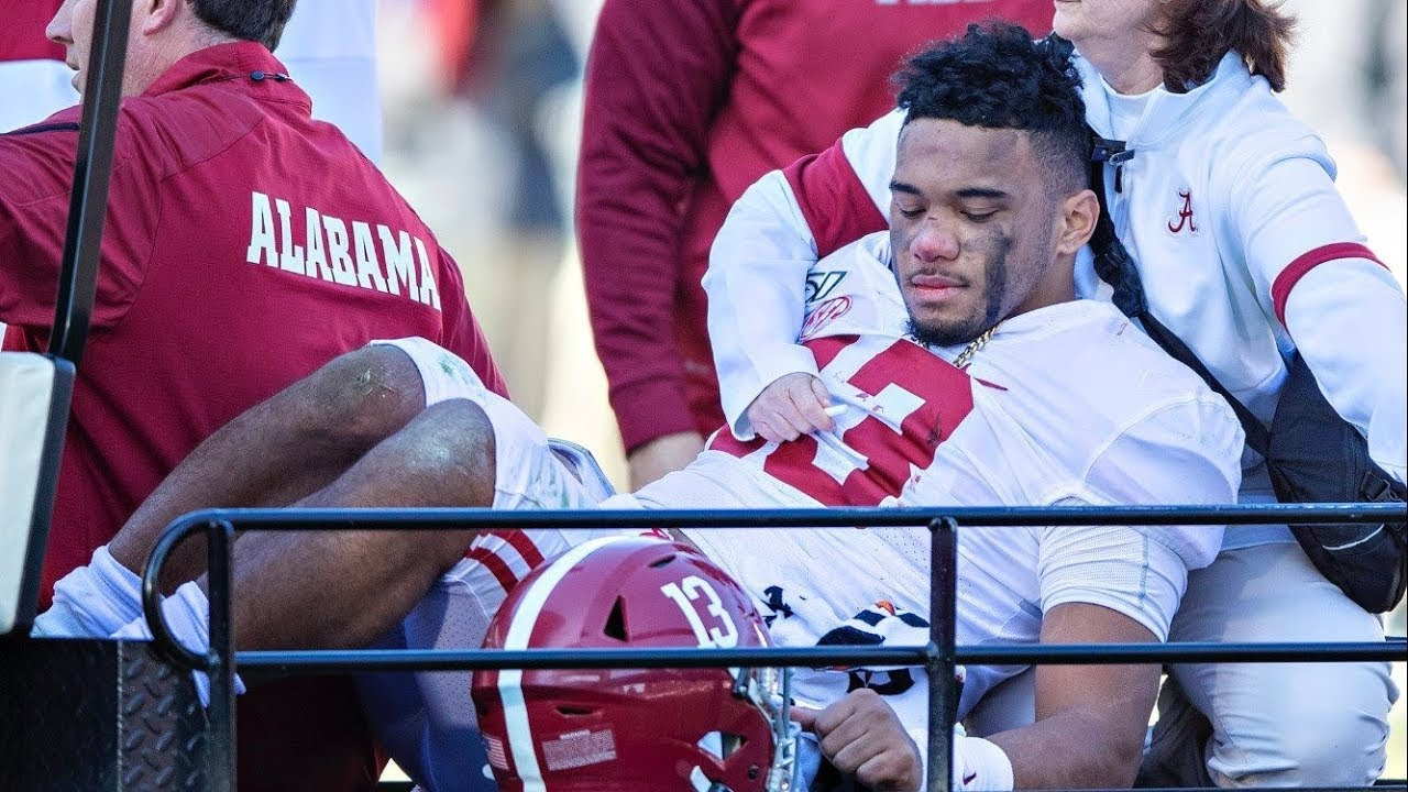 Tua Tagovailoa injury: Alabama QB carted off with hip issue, bloody ...