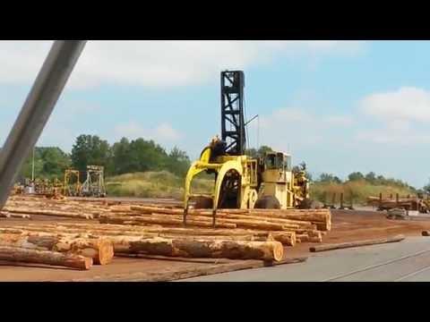 letourneau log stacker spreading huge load of logs