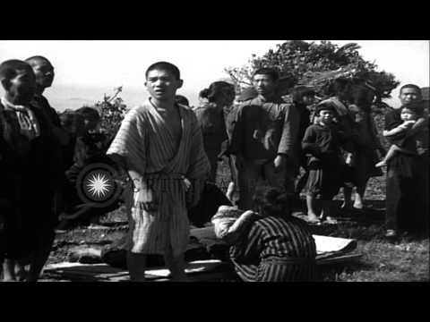 Citizens of Aguni Jima, Okinawa, Japan are seen gathered during the allied invasi...HD Stock Footage