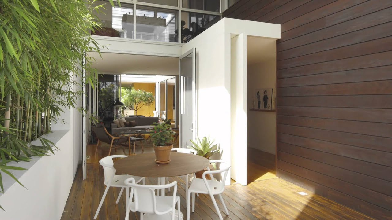 Queensland home formed around a central courtyard opens up to kitchen dining and living areas Kitchen design centre brisbane