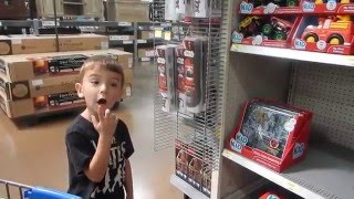 4 Year Old Child Shops For Trucks, Diggies And Toys At Walmart