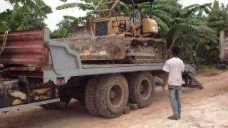 Bulldozer MITSUBISHI BD2F moves of truck trailer Kamaz បុលចុះពីឡានដឹកម៉ាក Kamaz