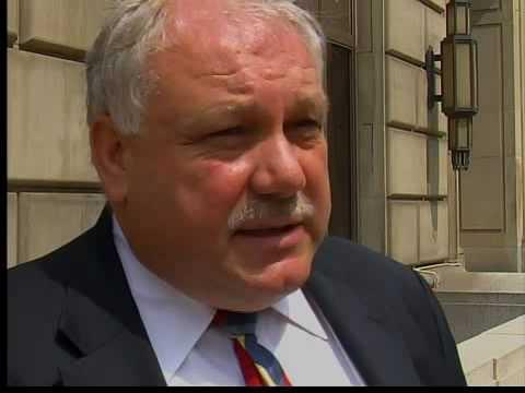 Akron mayor threatens police layoffs